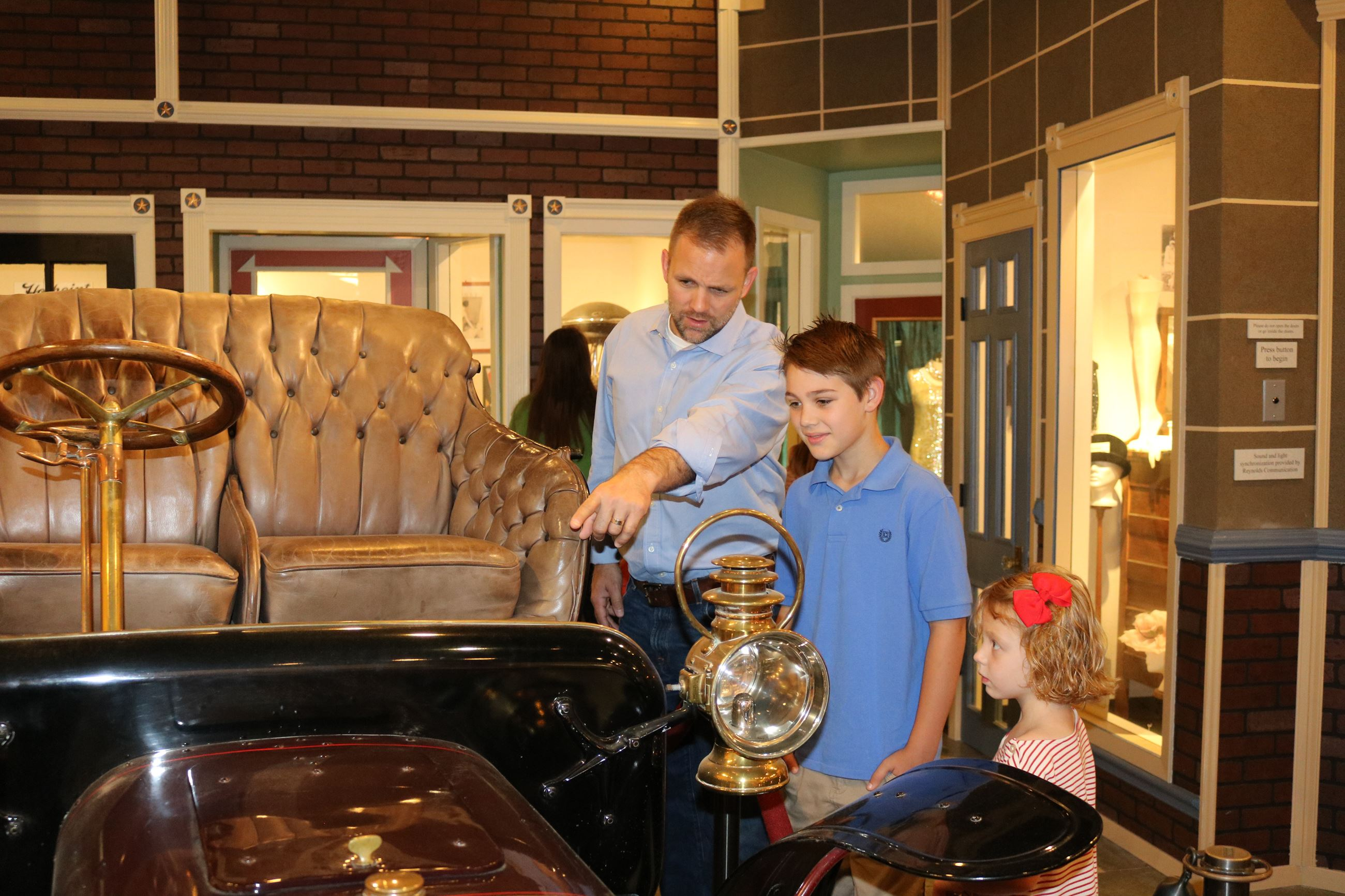 Museum, Family looking at antique car