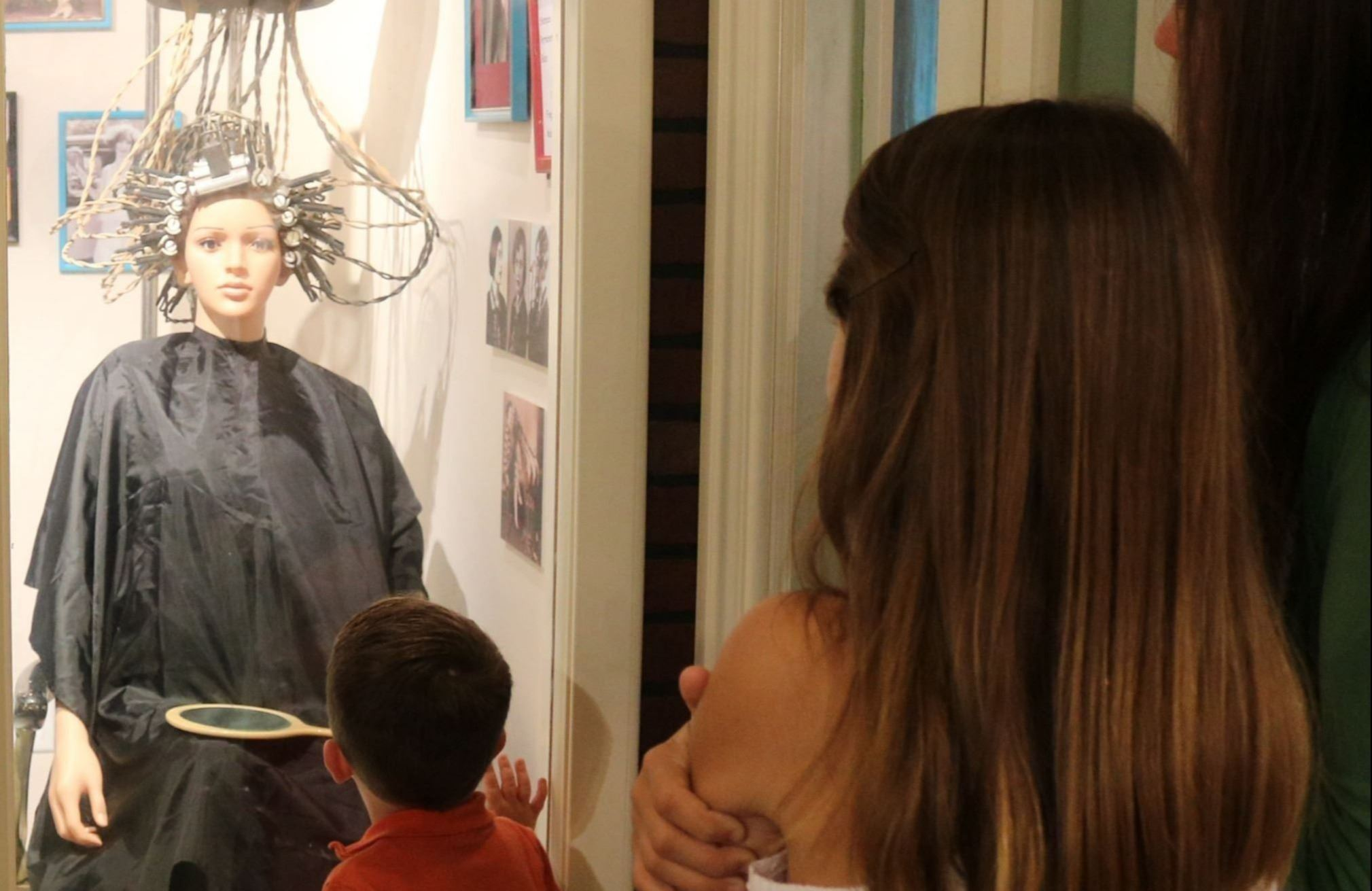Museum, Family looking at antique hair curler