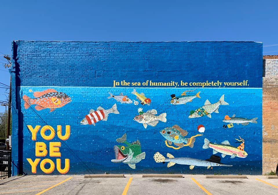 Large wall mural featuring many different fish titled You Be You by Laura Irrgang